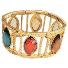 Open Designed Stretch Bracelet with Red, Green and Amber Accents