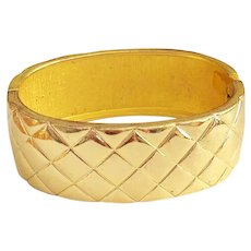 Hinged  Goldtone Bracelet with Pretty Quilted Design