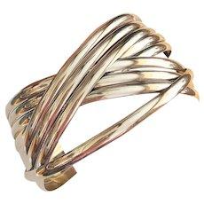 Multiple Intertwined Polished Silvertone Bangle Bracelets