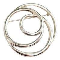 TRIFARI  signed Pretty Silvertone Circle Swirl Brooch