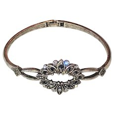 Hinged Silvertone Bracelet with Black and Clear Rhinestones