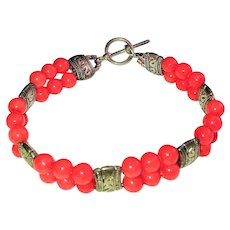 Beautiful Coral Color Glass Beaded Bracelet  with Pretty Silver Tone Accent Beads and Toggle Clasp