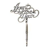 JJ signed Agent Of The Year Pewter Pin Brooch with a Pen Charm