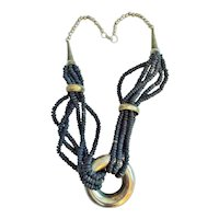 Multi Strand Black Wood and Silvertone Beaded Necklace with Silvertone Ring Pendant