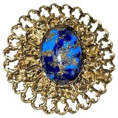 Round Filigree Goldtone Brooch with Pretty Blue Marbled Look Center