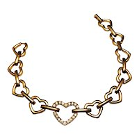 AVON signed Heart Linked Goldtone Bracelet with Pretty Sparkling Rhinestones