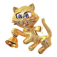 AVON signed Kitty Cat Holding a Bell Goldtone Pin Brooch with Blue Rhinestone Eyes