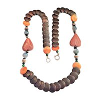 Carved Stone and Copper Necklace with Polished Stone Bead Accents