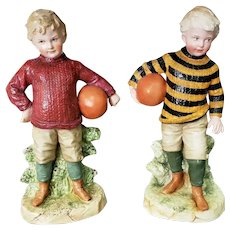 Pair of Late 19th Century German Gebruder Heubach Bisque Young Boy Football Player Figurines