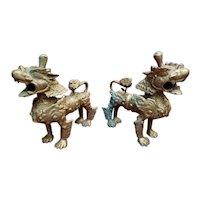 Pair of Mid 20th Century Tibetan Gilt Bronze Snow Lion Statues