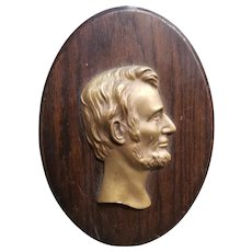 Mid 20th Century Abraham Lincoln Brass on Wood Raised Relief Portrait Plaque