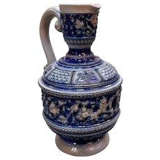 Early 20th Century French Salt Glazed Stoneware Lion/Floral Motifs Pitcher