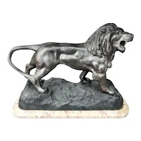 Circa 1920 French Art Deco Walking Lion Spelter Sculpture on Marble Base