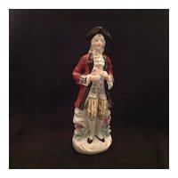 Colonial gentleman glazed bisque figurine Japan