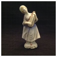 Unglazed bisque figurine lady with mandolin  Japan