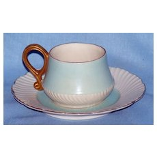 Rose Crown China pale blue miniature cup and saucer.