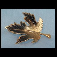 Burnished gold tone leaf pin