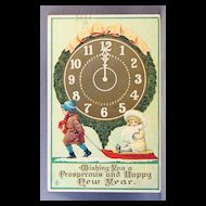 1912 New Year card with children on a sled