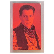 Arcade Card Warner Baxter cowboy movie star  red tint