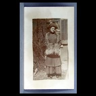 Real Photo Post Card with young woman wearing furs