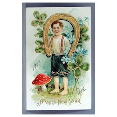 1907 New Year Postcard with four leaf clovers and a horseshoe