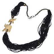 Vintage multi-stranded black seed bead necklace with bone elephants