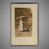 Real Photo Postcard Woman with automobile