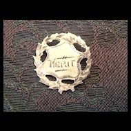 Unmarked Silver tone metal Merit pin