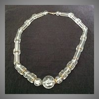 Chunky clear lucite necklace with industrial flair