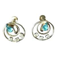 Vintage aqua and clear rhinestone screw back earrings in gold tone setting