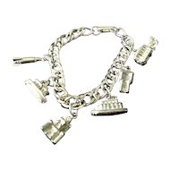 Silver tone charm bracelet with 6 charms