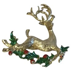 Christmas pin Goldtone Reindeer with Red and Green Enamel Holly