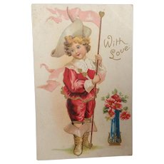 Unused Valentine postcard with embossed young boy in red suit and boot