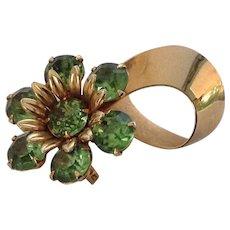 Green prong-set rhinestone flower pin with gold tone ribbon