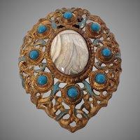 Huge ornate dress or fur clip
