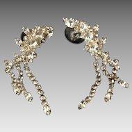Shimmering rhinestone drop pierced earrings in gold tone metal setting