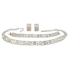 Shimmering rhinestone parure with pierced earrings.