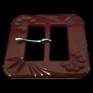 Vintage deeply carved brick red bakelite belt buckle