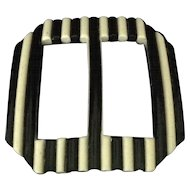 Vintage extruded celluloid black and cream belt buckle