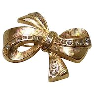 Napier gold tone bow set with rhinestones