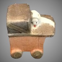 Miniature bisque baby in a buggy figurine for doll house family.