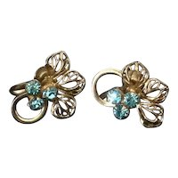 Turquoise blue rhinestone and gold tone filigree flower screw back earrings