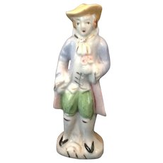Colonial gentleman glazed bisque figurine with bouquet Japan