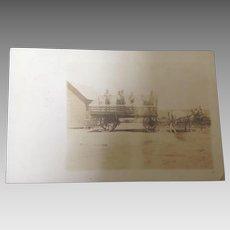 Unused real photo postcard Farmers on Horse Drawn Wagon
