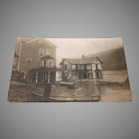 Real Photo Postcard with houses after a flood