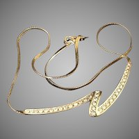 Monet Necklace with freeform rhinestone ribbon and gold tone herringbone chain