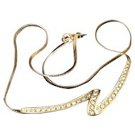 Monet Necklace with freeform rhinestone ribbon and gold tone herringbone chain