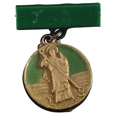 Vintage St. Patrick religious medal with green bar pin