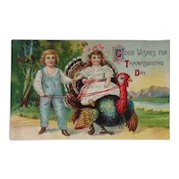 1909 Postcard Good Wishes for Thanksgiving Day with Girl Riding a Turkey
