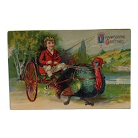 1909 Thanksgiving postcard with Turkey Pulling a Boy in a Cart